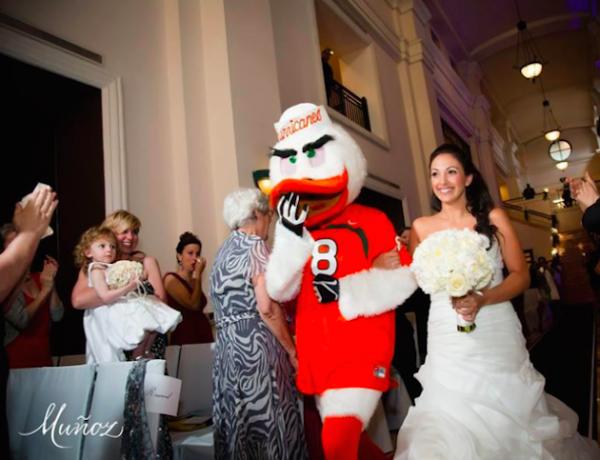 Bride escorted down the aisle by Miami Hurricanes Mascot